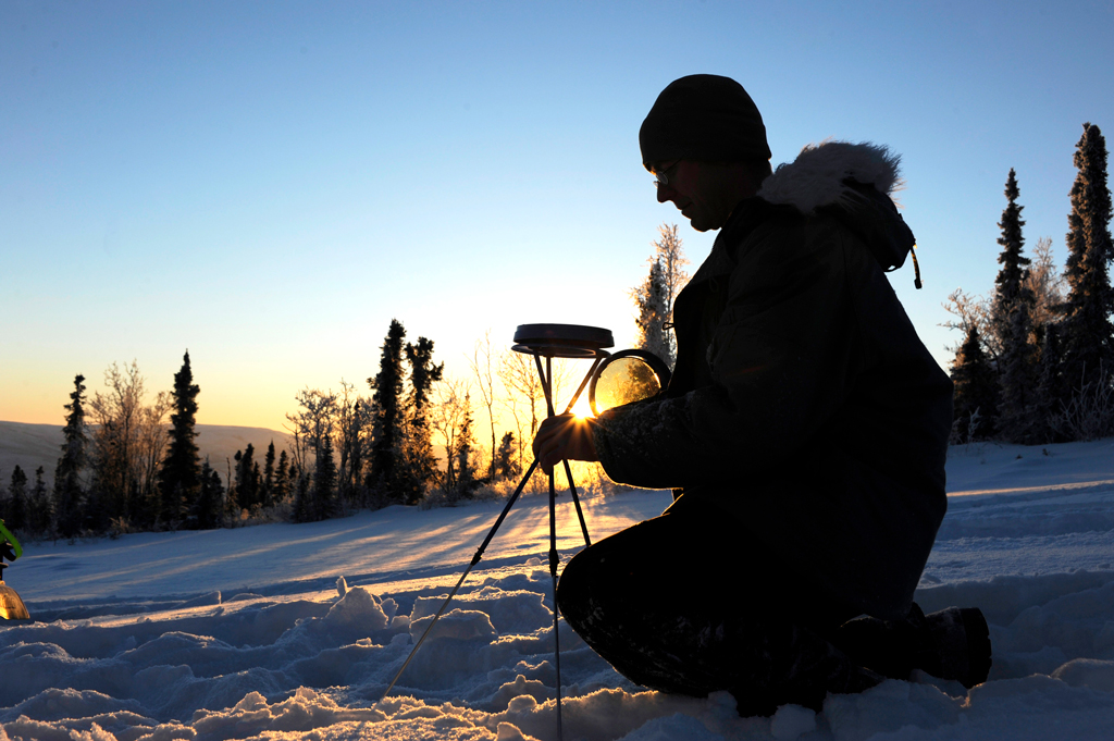 Technician gathering data in the Arctic